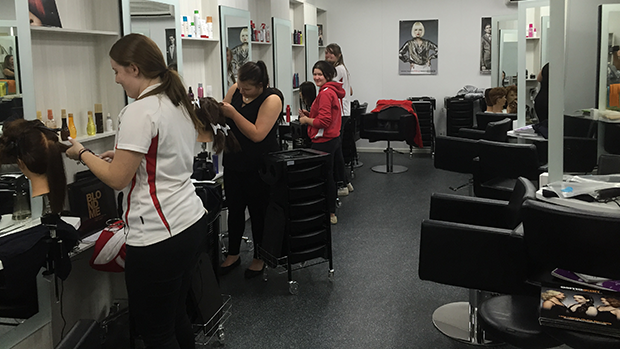 Hairdressing students at TAFE.